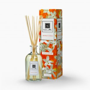 Nabila K's Jasmine and Honey with reeds inside the bottle with it's packaging next to it
