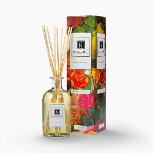 Nabila K's Rose Garden with reeds inside the bottle with it's packaging next to it
