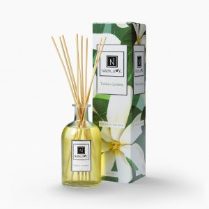 Nabila K's Tahitian Gardenia with reeds inside the bottle with it's packaging next to it