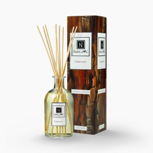 Nabila K's Cedarwood with reeds inside the bottle with it's packaging next to it