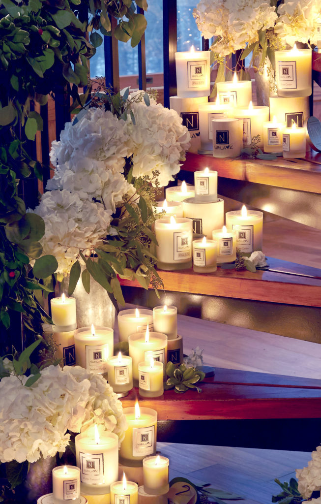 A Variety of Nabila K's Lit Candles on Steps Leading Up