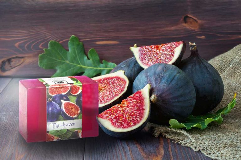 1 Bar of Nabila K's Fig Heaven Soap next to sliced and whole figs