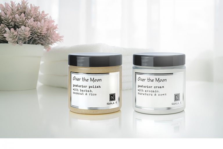 1 5oz Jar of Over the Moon Posterior Polish with baobab cocnut and rice next to 1 5oz Jar of Over the Moon Posterior Cream with Avocado Murumuru and Neem