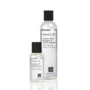 1 Travel and 1 Large Sized Bottle of Nabila K's Coconut Milk Collagen and Biotin Shampoo with Manuka Honey and Jojoba