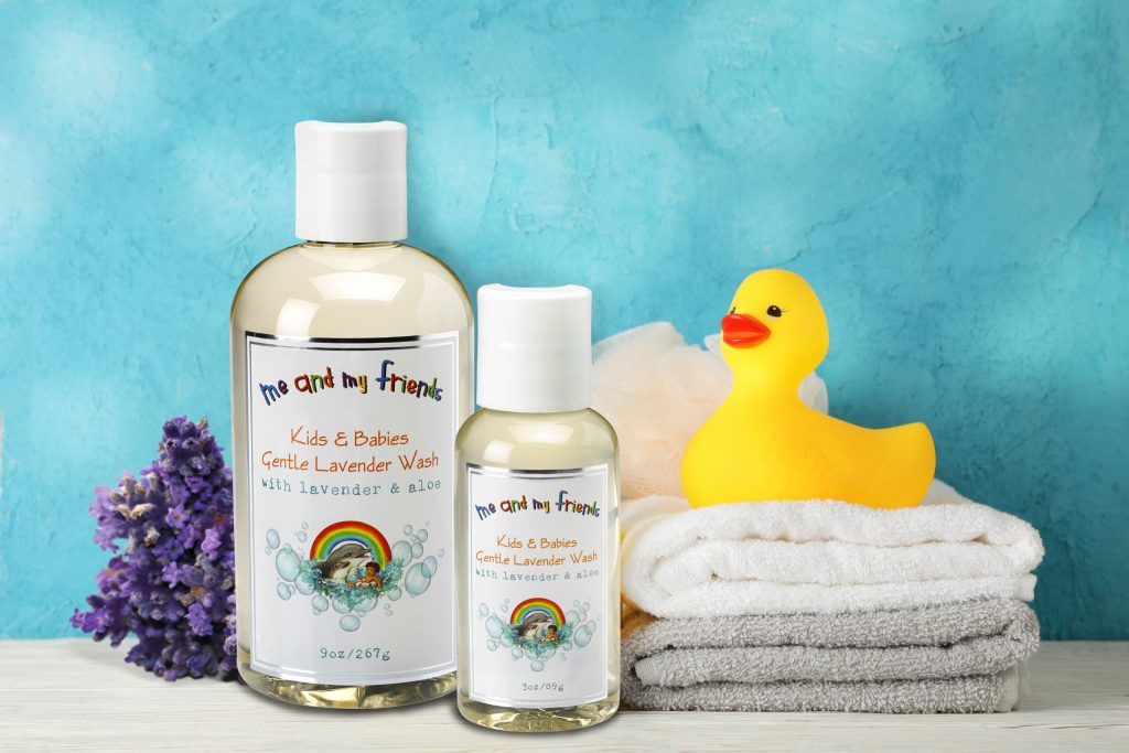 Baby wash surrounded by the towels, lavender flowers and toy duck.